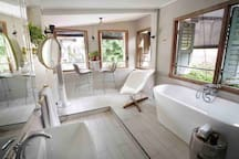 The huge open space bath area with row of shuttle windows overlooking the inner bougainvillea garden and back lane of Melaka. Smoking is possible at this open air bathroom.