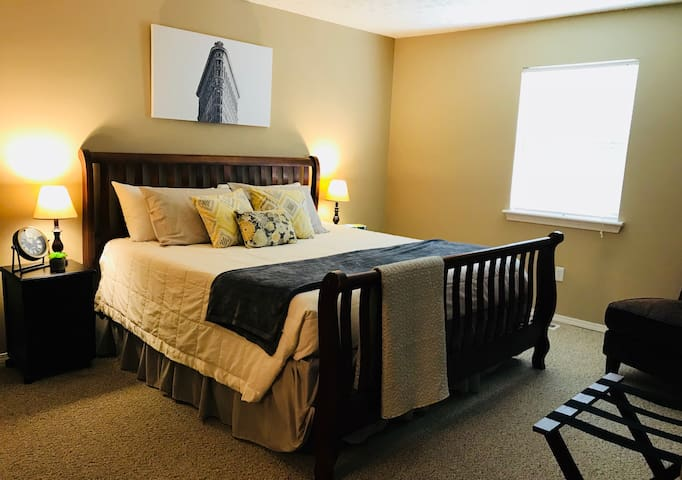 Plush King size bed with hypoallergenic pillows and mattress covers.