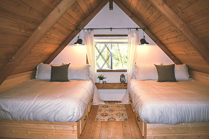 Tuck yourself in to a comfortable queen bed with built in reading light after an adventure packed day!