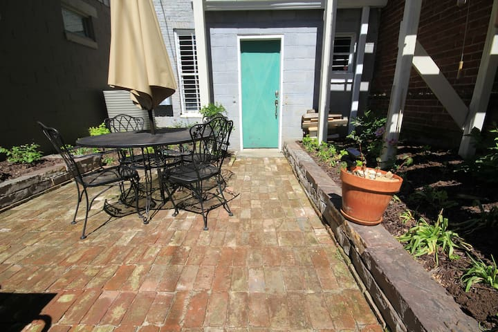 Quaint, private rear patio. Hand laid stone work.