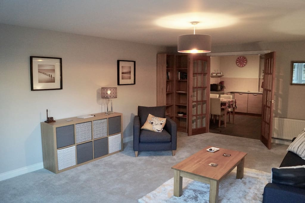 Spacious Lounge leading to Fully Equipped Kitchen