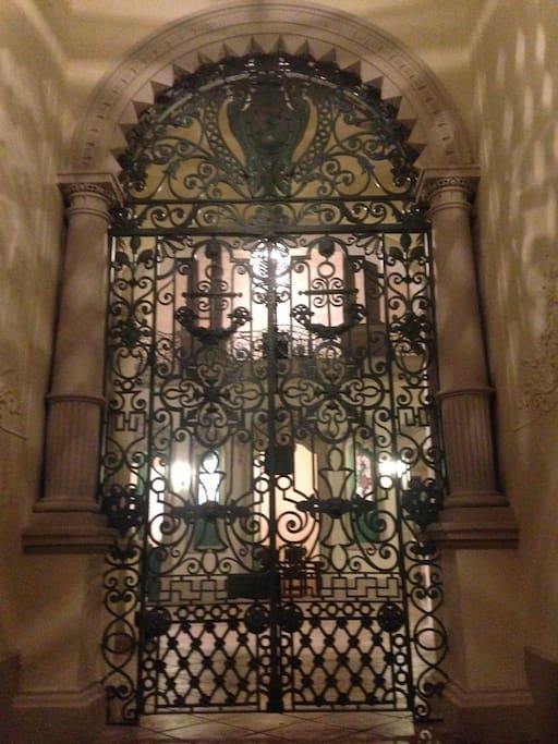 Wrought iron gate in entrance hall.