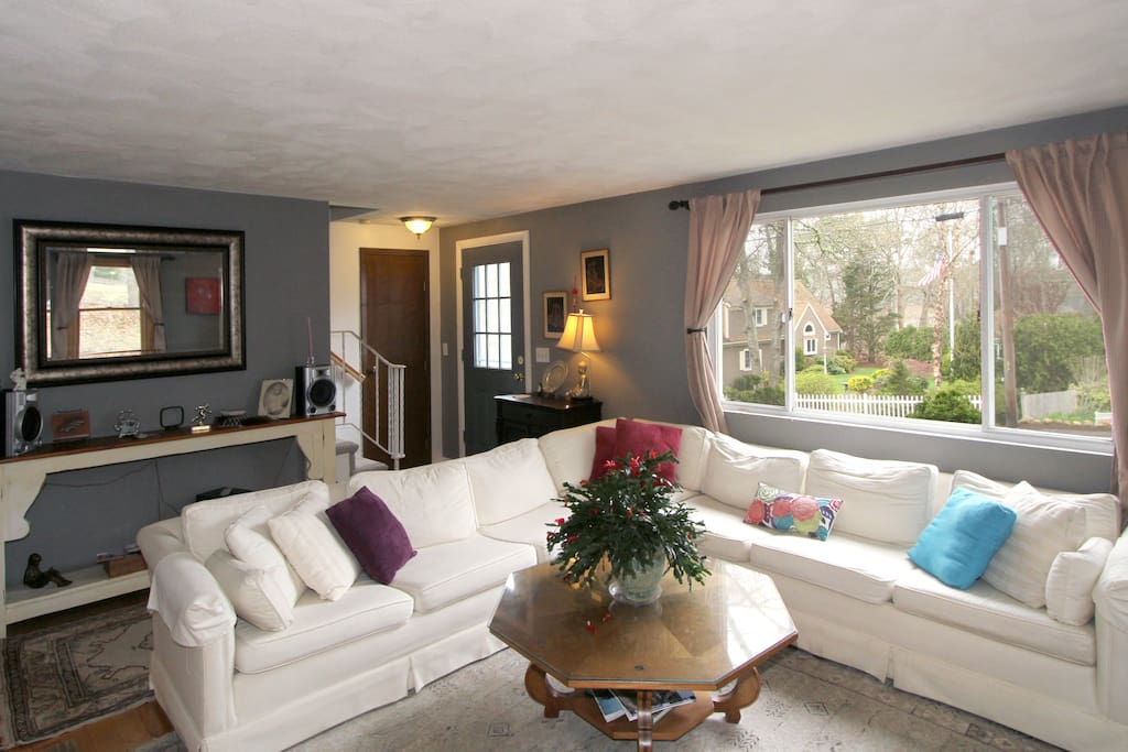 The living room is perfect for gathering guests over hors d'oeuvre and drinks with a large white sectional sofa.