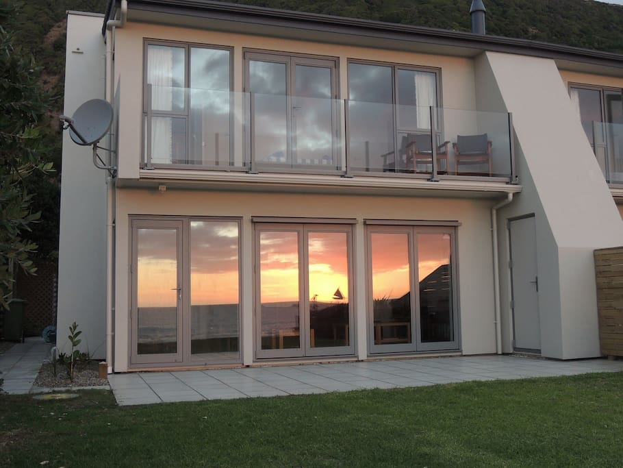 Sunset reflected in beach-side bifolds