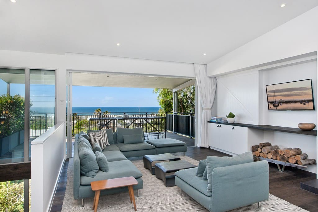 House One upper level living room onto ocean view deck