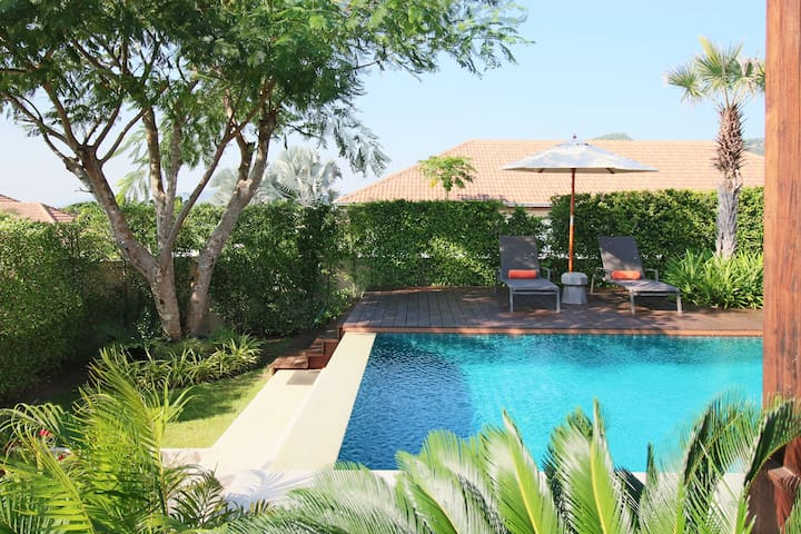 Resort-style garden with full privacy and stunning views.