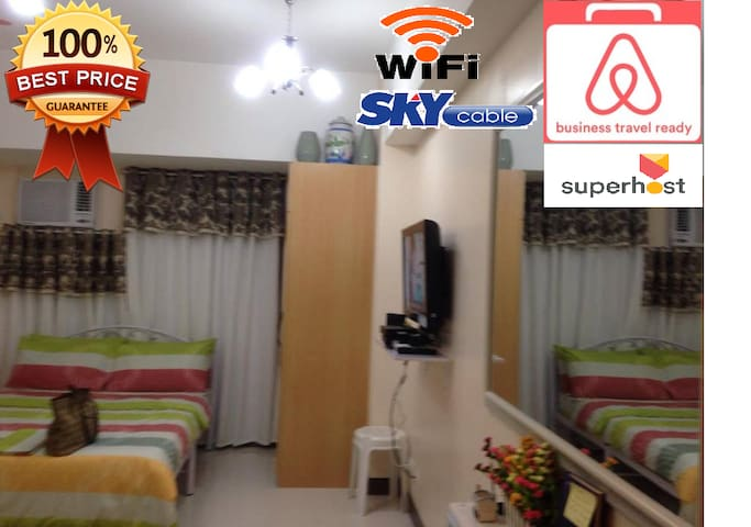 Mckinley Condotel GreenView with Wifi & Parking