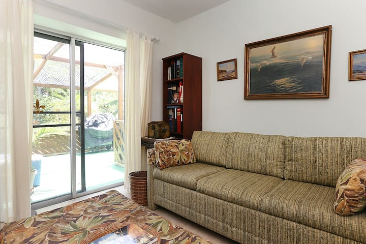 Den with sofa bed and access to private screen porch