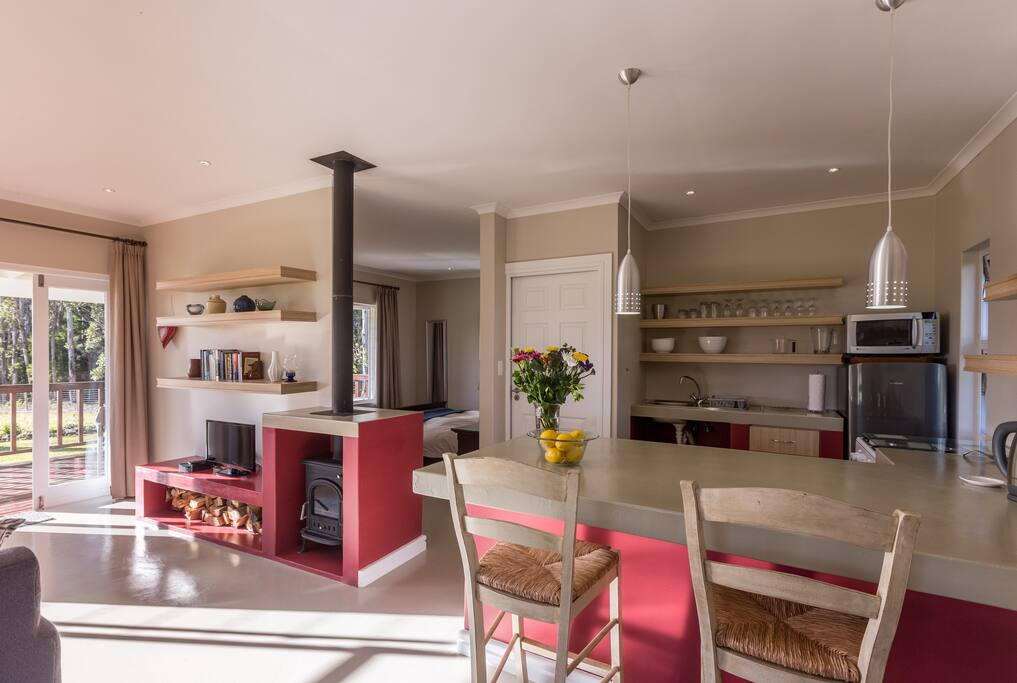 Light modern open plan kitchen with all the necessary kitchen essentials.