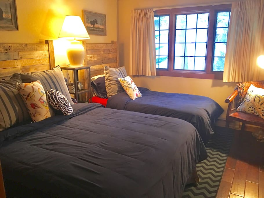 "Private sleeping area, ""guest room"", includes a queen bed and a twin bed."