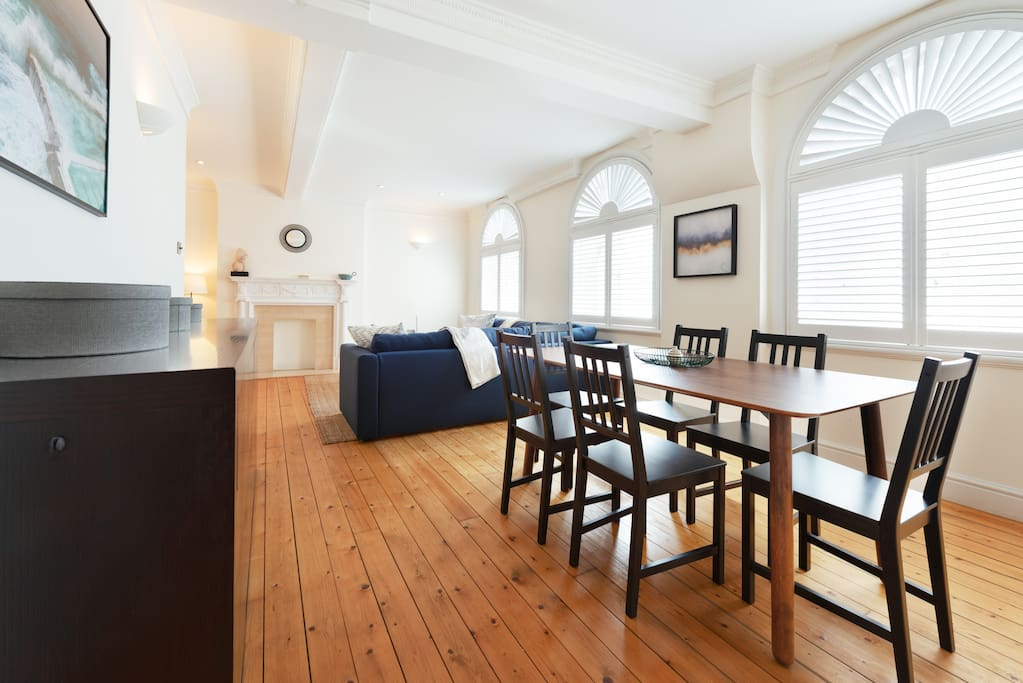 With a dining table and wooden floors...