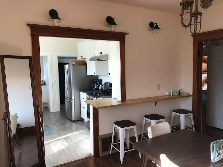 Dining room with breakfast bar/work Area with USB charging ports, semi-open to kitchen