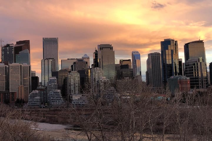 Enjoy cityscapes and sunsets from McHugh Bluff, a five minute walk from the laneway house.
