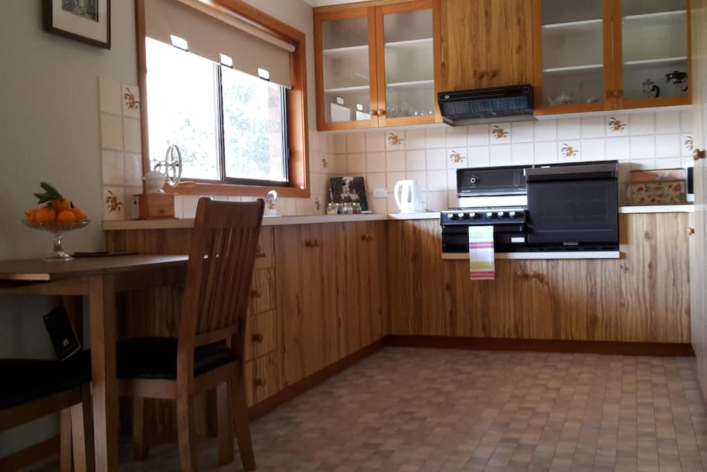 Sunny kitchen and dining area with everything you need for your convenience