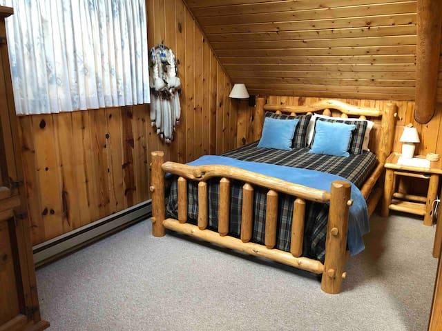 Queen log bed in loft