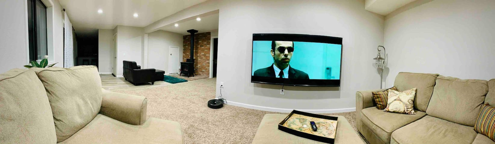 """Spacious living room space with 75"""" 4K UHD Roku TV with Netflix, Amazon Video, and HDMI cable or stream from your device; large couch and separate seating in front of the fireplace :-)"""