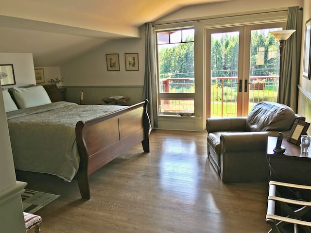 1st Bedroom with a queen bed and access to private balcony.