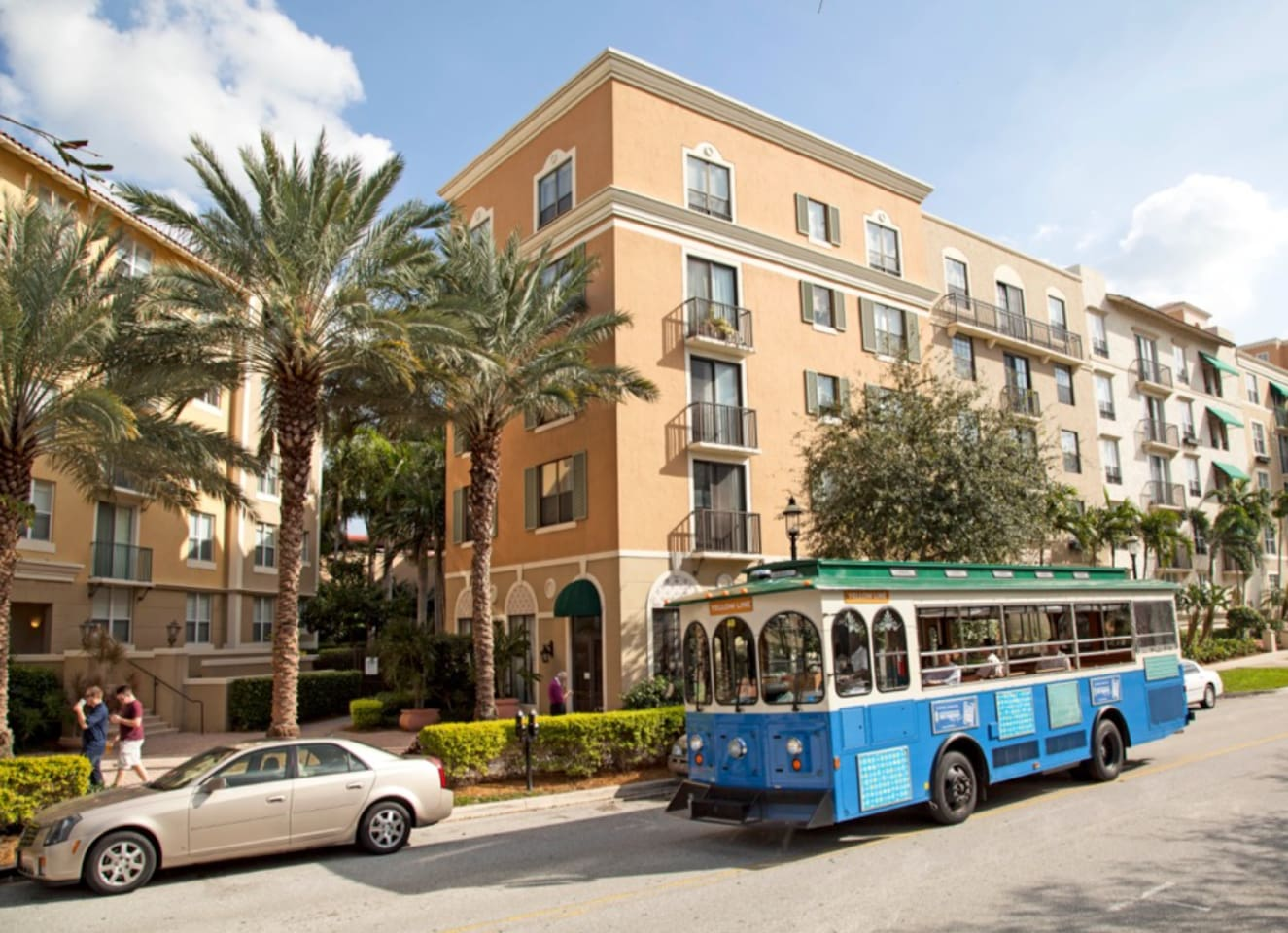 Free Trolley passing by the  Condominium on its way to Clematis Street Restaurants and Green Market