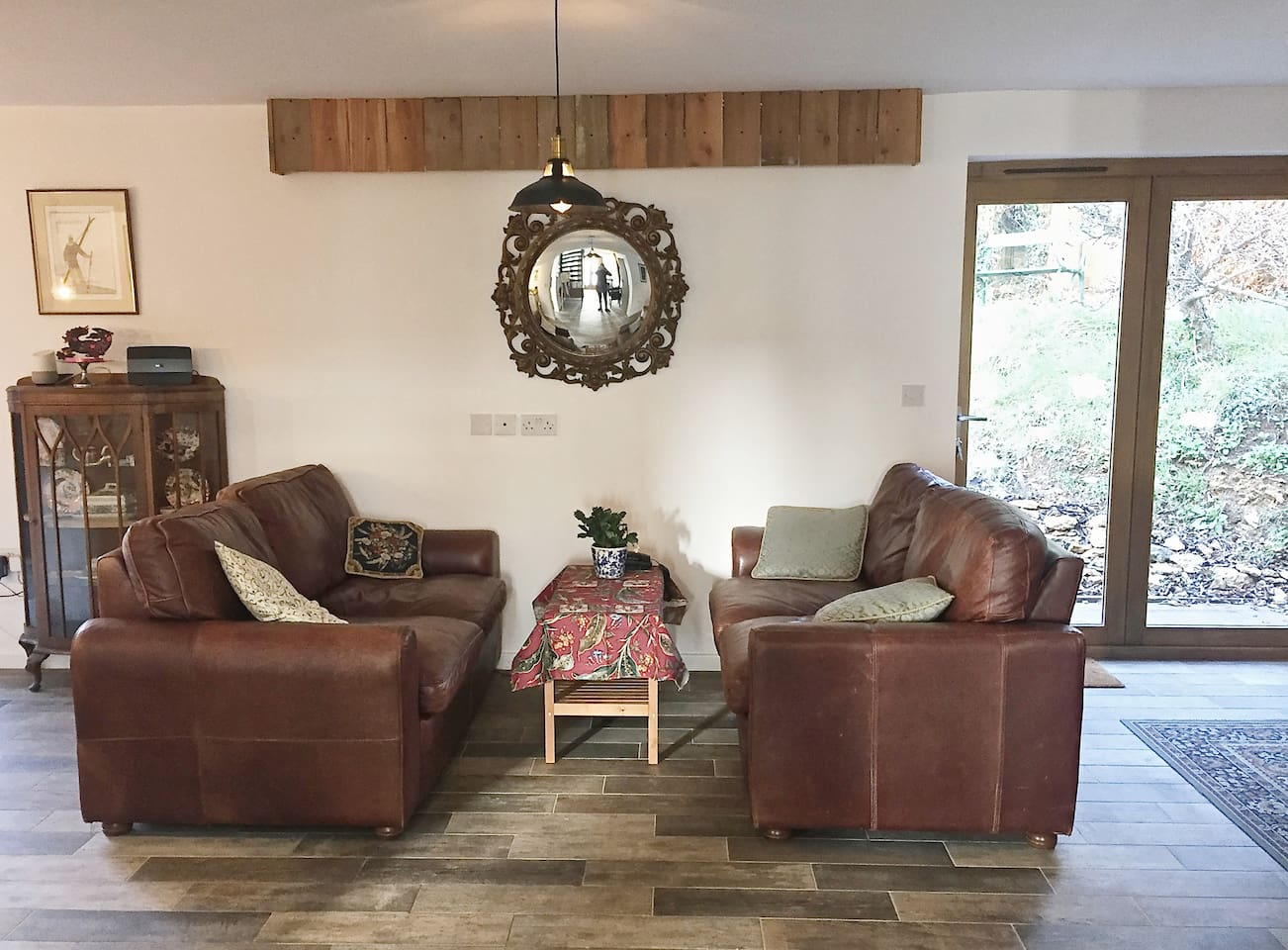 Snug Vintage Second Hand and Locally Sourced Leather Sofa Seating to kick back on.
