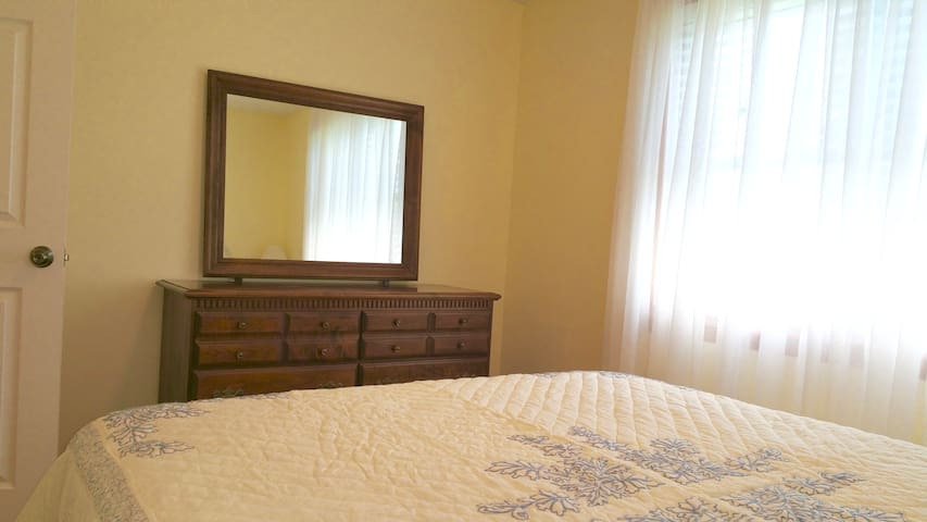 South bedroom.  Queen bed.  Dresser with large mirror.