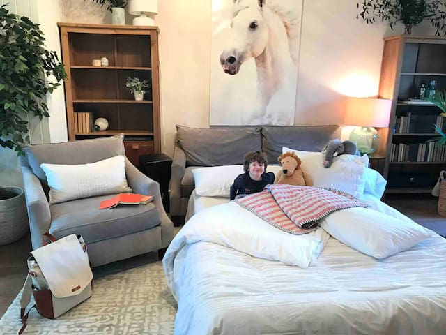 This is a wonderful place for children to feel at home away from home. Cozy, fun and roomy, the living room bed option let's kids stretch out, have snacks, bedtime stories and still sleep super close to you in the next room.
