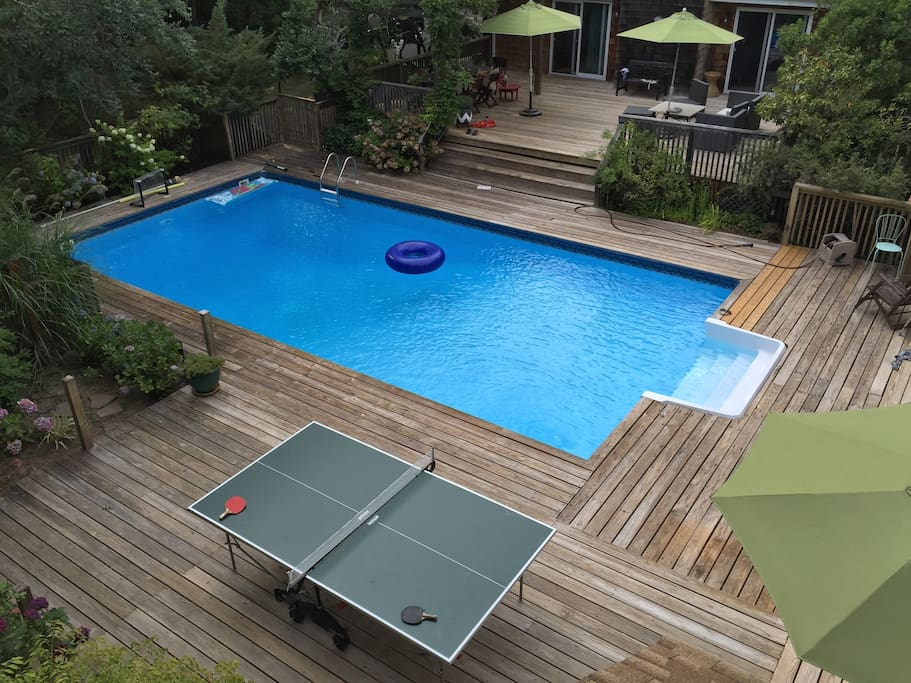 2 decks with pool and outdoor shower, outdoor dining room and lounge, ping pong table, basketball hoop