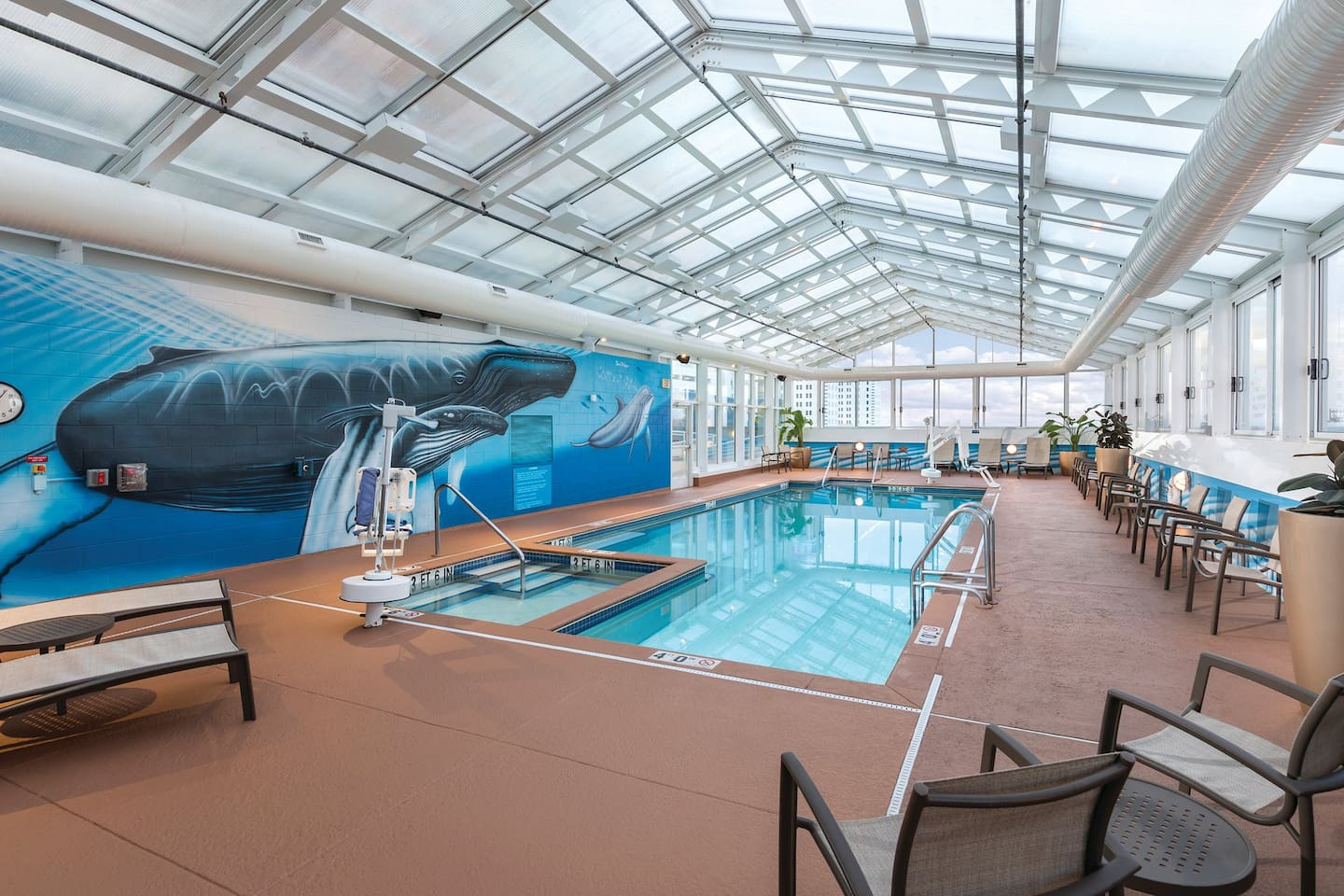 Take a dip in the pool, year round!  This swimming pool sits rooftop. It has a retractable roof, so when the weather is nice, this indoor pool, becomes an outdoor pool!