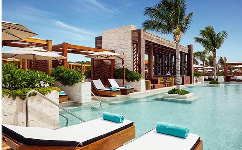 Grand Luxxe secluded beach area and pool