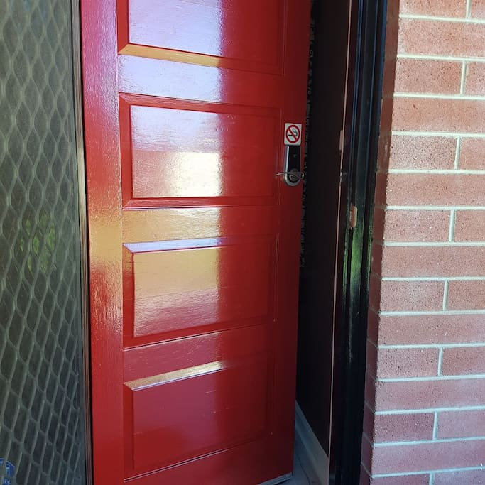 red door entrance with key code
