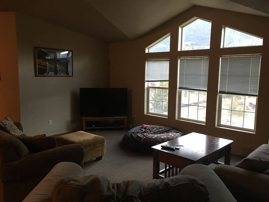 Living area with full cable and spectacular views of Mt. Royal, Peak 1, Buffalo and the Continental Divide!