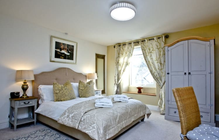 Master bedroom with double bed and linen and towels provided