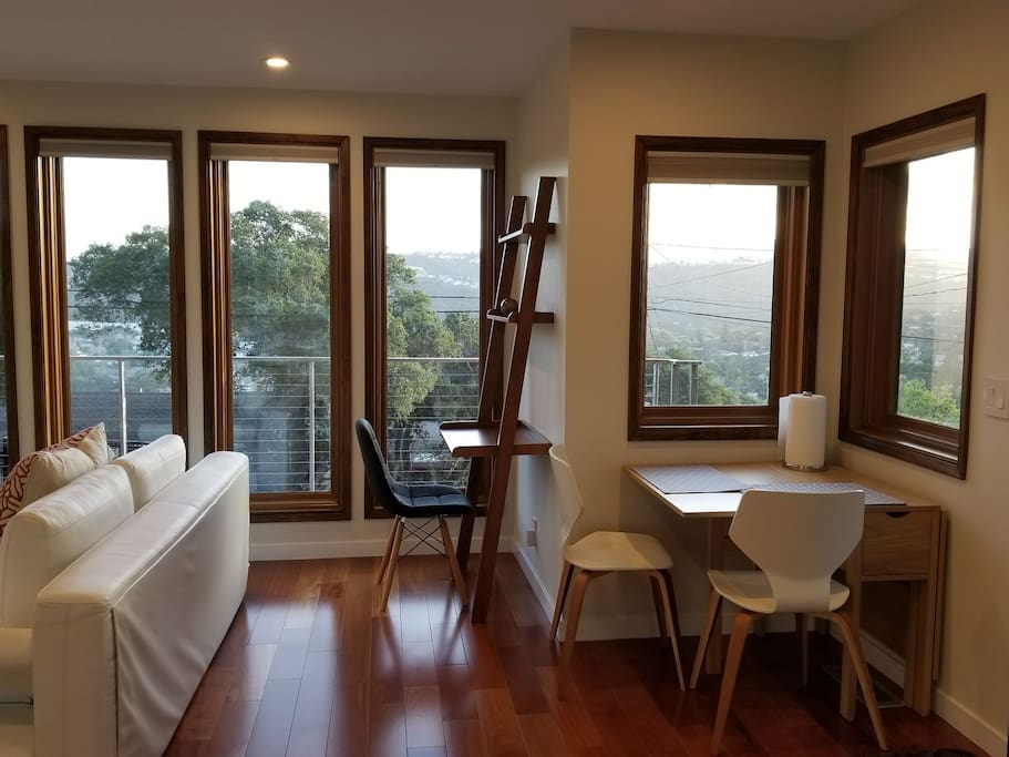 living room with desk area and dining table - plenty of windows and beautiful views of Belmont canyon