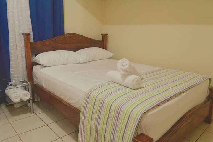 Bedroom 1: double bed with fan