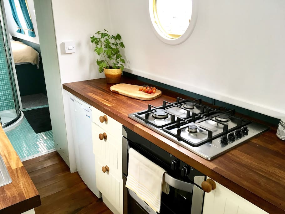 Beautiful kitchen with breakfast bar, fridge, gas cooker and all the necessary utensils
