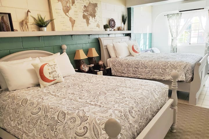 Sleep overs I7will never be the same once you experience this fun double Queen bedroom.