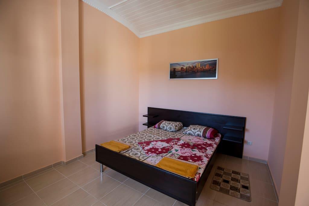 Cпальня в двухкомнатном номере