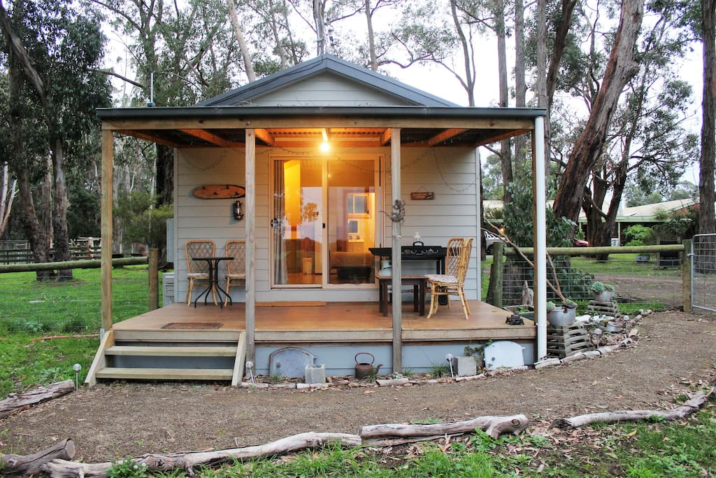 Front of cabin looking out to open paddocks and gardens.