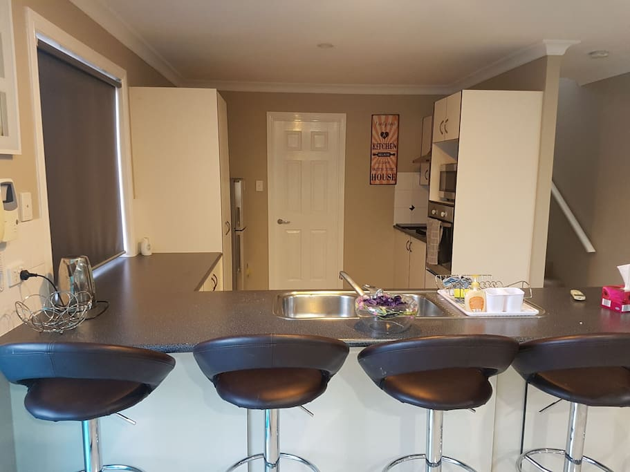 Great kitchen with large breakfast bar, good pantry and plenty of bench space. Powder room and internal laundry also downstairs.