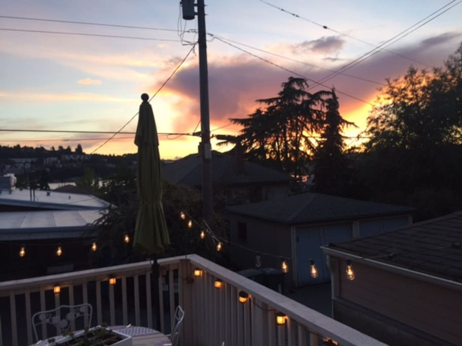 Private deck with sunset view of Lake Union