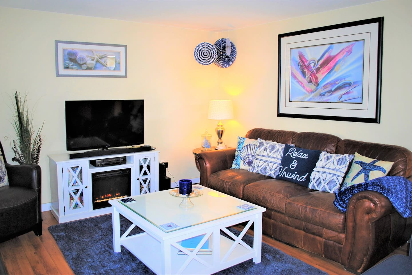 Comfy living room with  beach themed decorations.