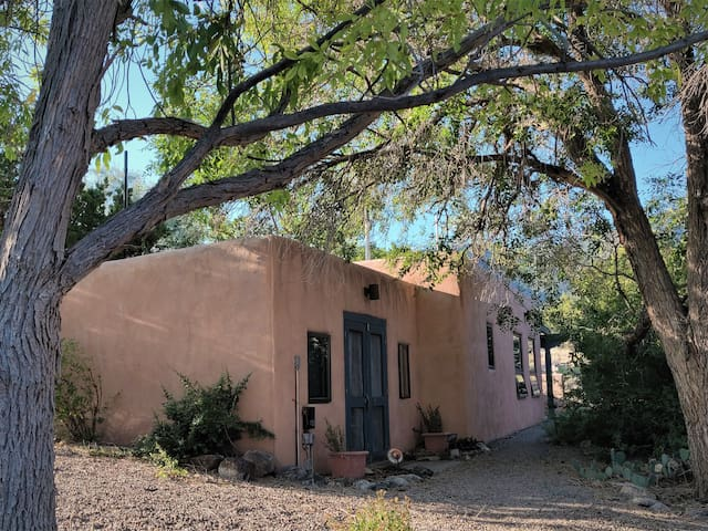The casita is located in a shady nook under large trees, but still has a mountain view.
