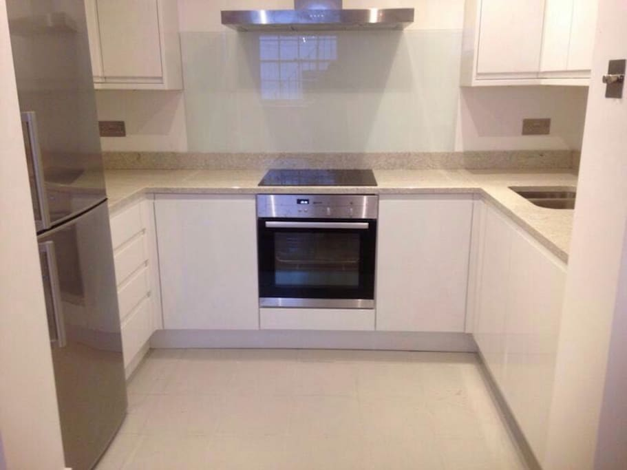 Kitchen, cooker, oven, fridge, microwave, toaster, kettle, dishwasher, cutlery