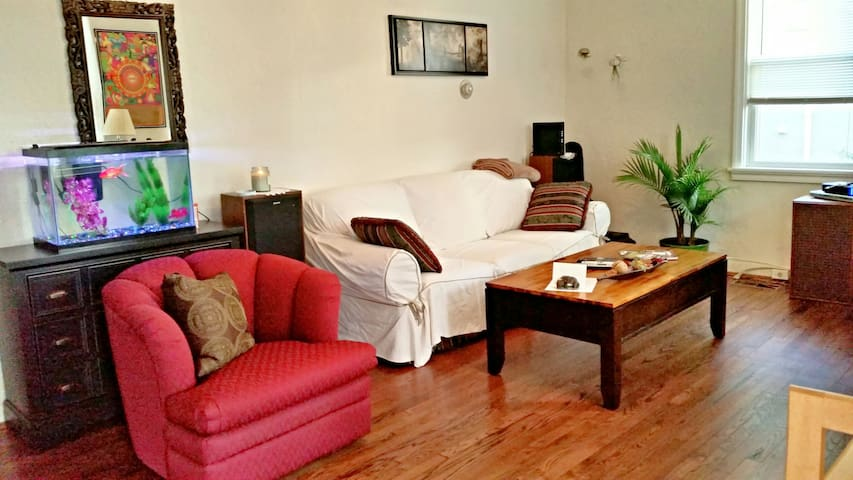 Cozy living room overlooking Rayon Street with great sunset views!  Comfy couch and cable TV.