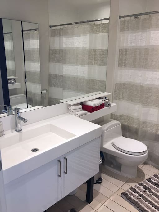 Private bathroom with bathtub. Your bathroom will be stocked with toilet paper, towels, hand soap, lotion, shampoo, conditioner, and body wash.