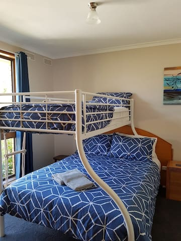 The second bedroom with room for the family.