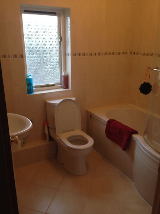 This is your private bathroom with large bath, toilet, sink and electric shower. We can provide towels if needed.
