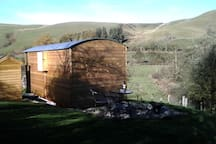 View of the shepherds hut with surrounding hills.