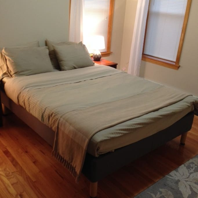 Master bedroom with queen size bed view 2