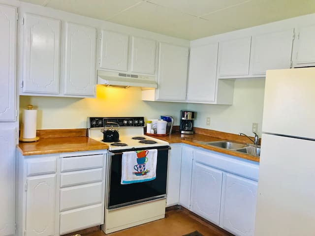 Fully usable kitchen with table for 6 inside and picture windows and front door directly to outside patio