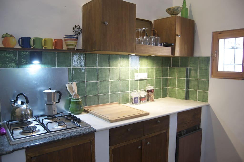 Kitchen with fridge and hot water.